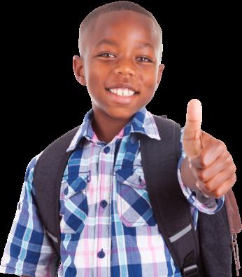 boy smiling while raising his thumb up